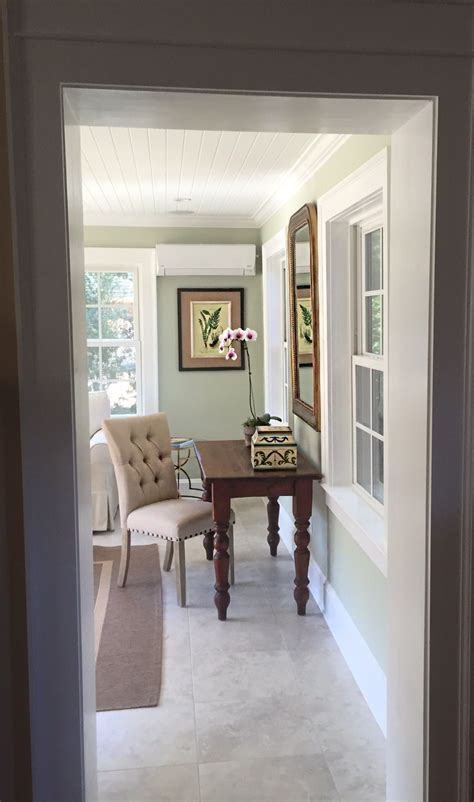 tsigns remodeled sunroom paint sherwin williams liveable green