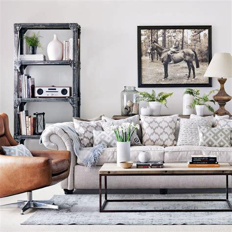 blue walls brown furniture light living room large