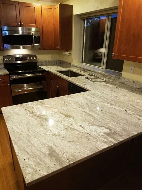 white glacier granite counter tops maple cognac cabinets