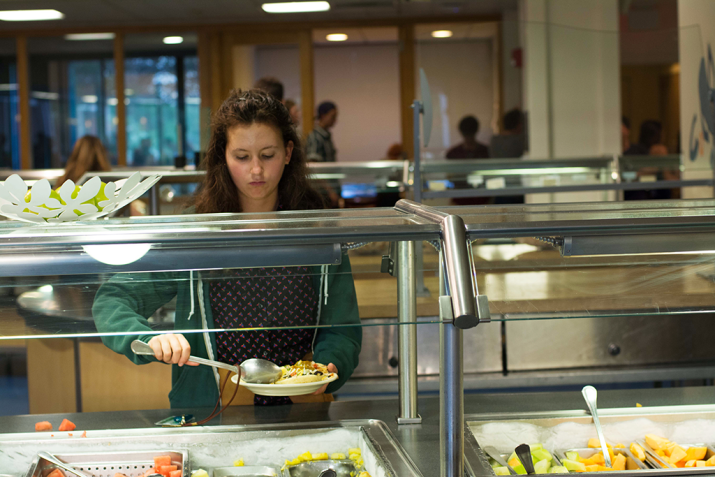 A student serves themselves in a dining hall