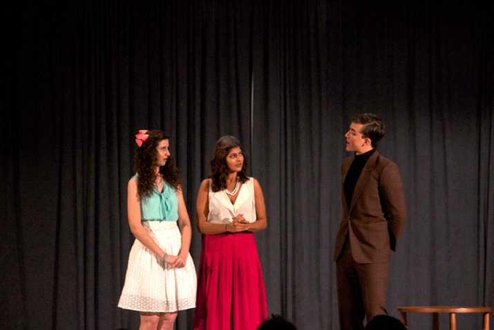 Two girls and one man talk to each other