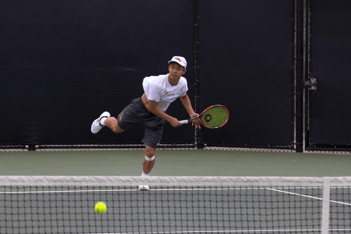 A man hits a tennis ball