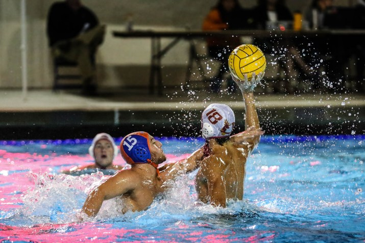 Three water polo players in the water