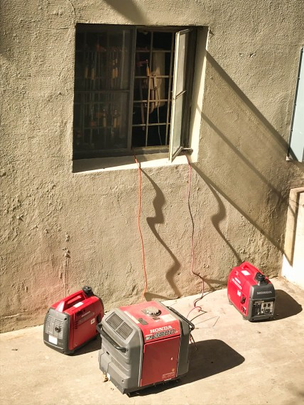 Three generators outside a Pomona dorm