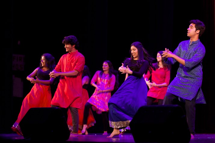 Students perform a Punjabi dance onstage