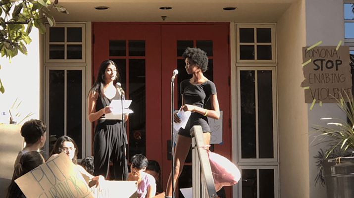 Kay Calloway PO '18 and Sagarika Gami PO '18 speak at a protest outside Pomona's Alexander Hall.
