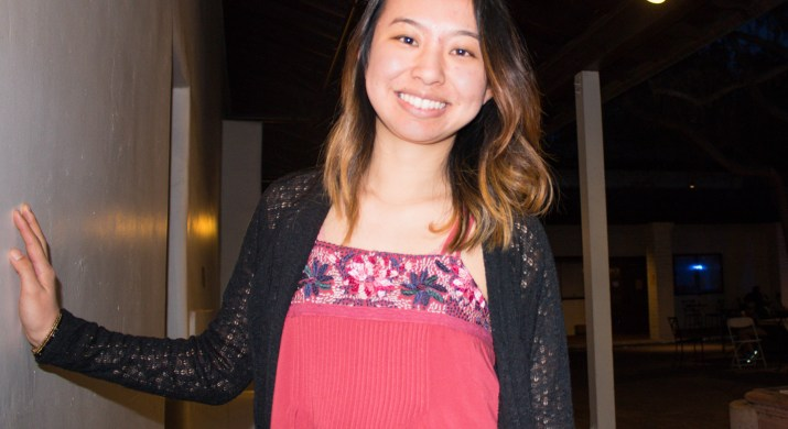 Sophia Hui PO '19 is wearing a coral red tank top and a black cardigan.