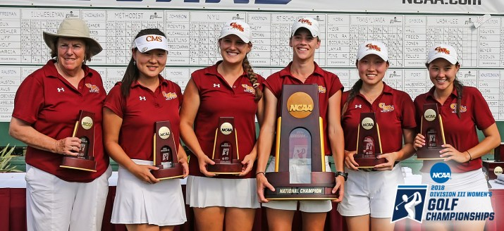The CMS women's golf team wear their red and white uniforms as they hold their NCAA Championship trophies.