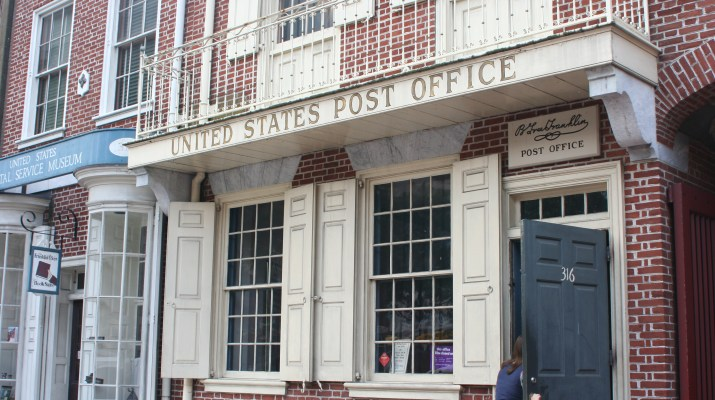 The streetfront of a brick post office