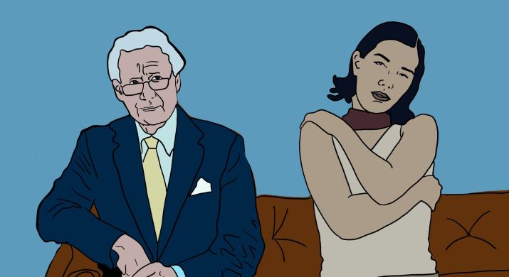 Philip Anschutz, in a suit, sits next to a female artist set to perform at coachella