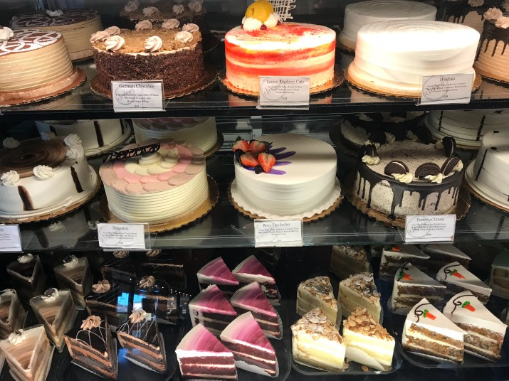 A Picture Showing Three Shelves Of Cakes On The Top Shelf From Left To