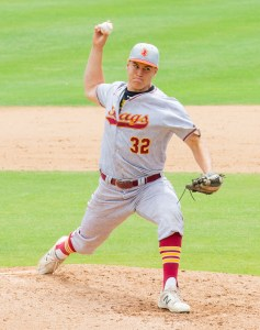 The pitcher throws the ball.
