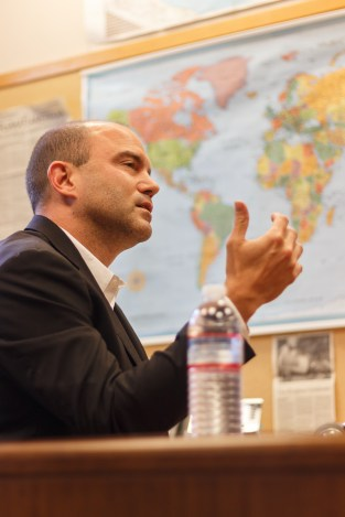 Ben Rhodes, the former national security advisor for the Obama administration, is a middle-aged white man with balding hair. He sits at a table in a suite, discussing his new book, the Trump presidency and Haifa controversy. In the background is a map of the world.