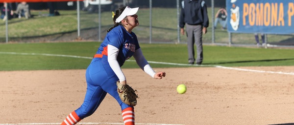 The P-P pitcher, wearing a blue jersey, pitches the ball with her left hand.