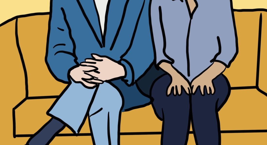 "A graphic of ""The Good Place"" characters Michael and Eleanor sitting side by side. Michael (left) wears glasses, a dark blue blazer, a bowtie, light blue pants and brown shoes. Eleanor wears a blue shirt, navy pants and white shoes. They are both sitting on a mustard yellow couch."