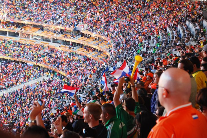 Fans pack into a stadium to cheer on their favorite teams.