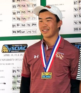 Mason Chiu smiles, gold medal gleaming around his neck.