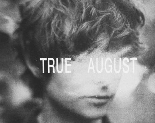 """Boy with face covered by text that reads """"True August"""""""
