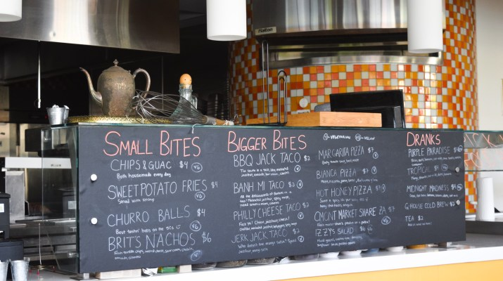 A menu with various food items written on a chalkboard.