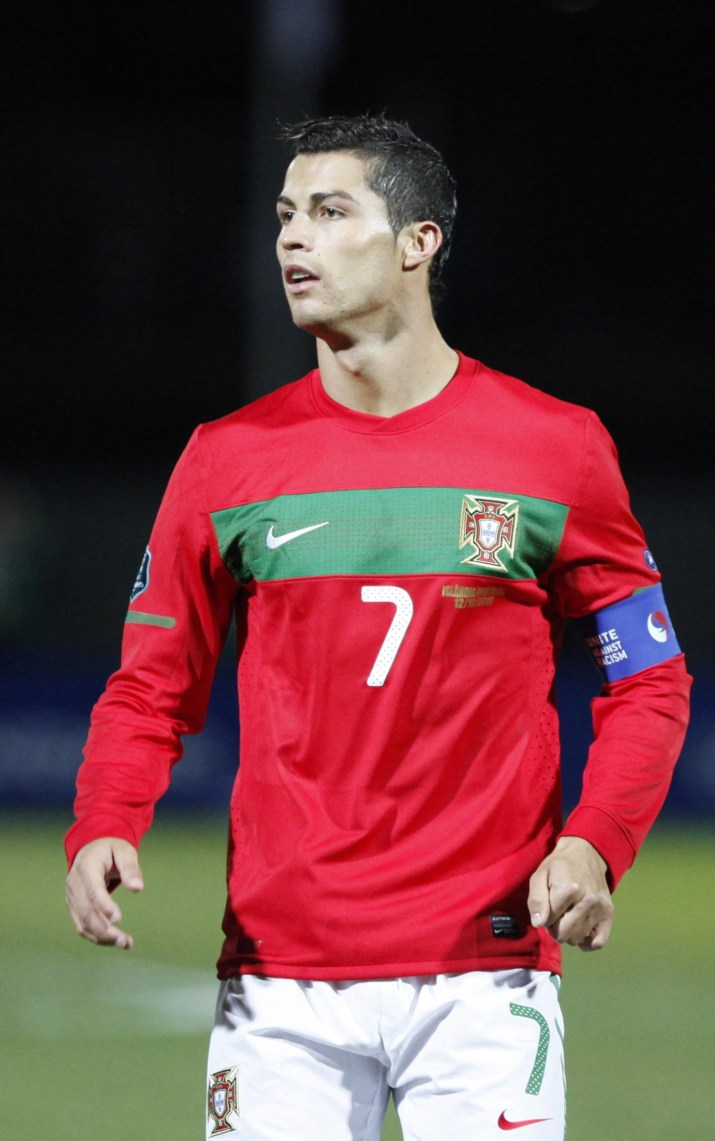 A male athlete in a red shirt stares forward.