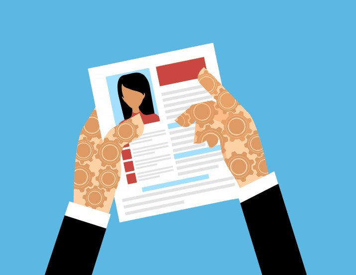 Two hands holding a resumé. The hands are patterned with gears.