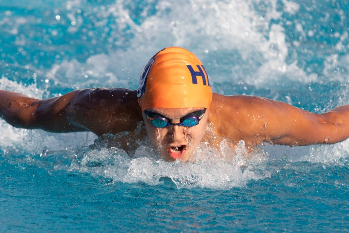 A male athlete with an orange camp swims.