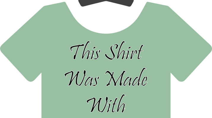 "A green shirt on a hanger. The shirt has the words ""this shirt was made with sweatshop labor!"" printed on it in script font."