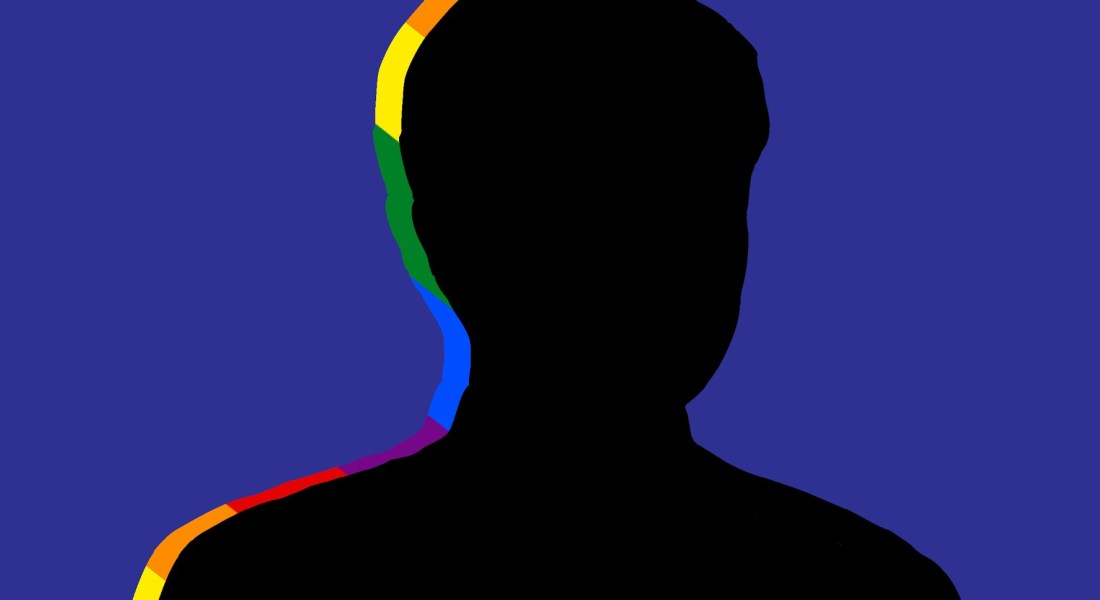A silhouette of a man with a rainbow outline.