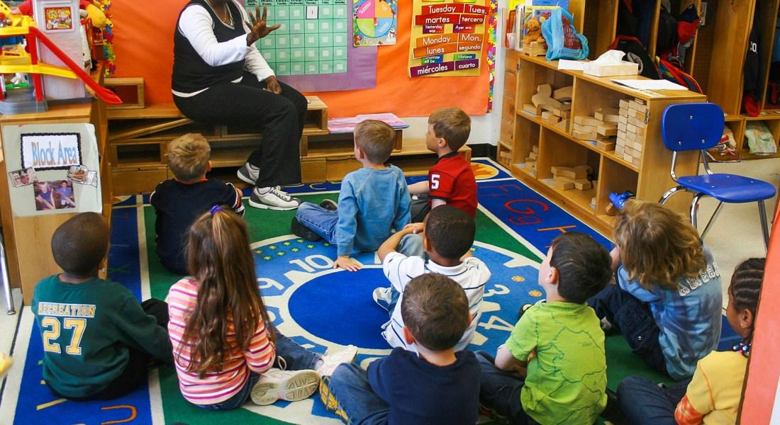 A teacher teachers a group of kindergarten students