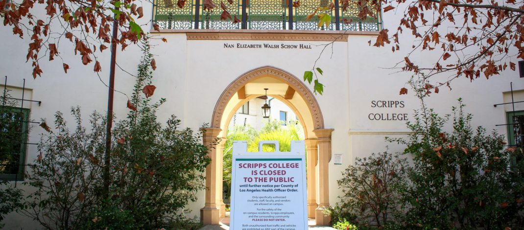 "A sign reading ""Scripps College is closed to the public"" sits in front of Scripps' NEW Hall"