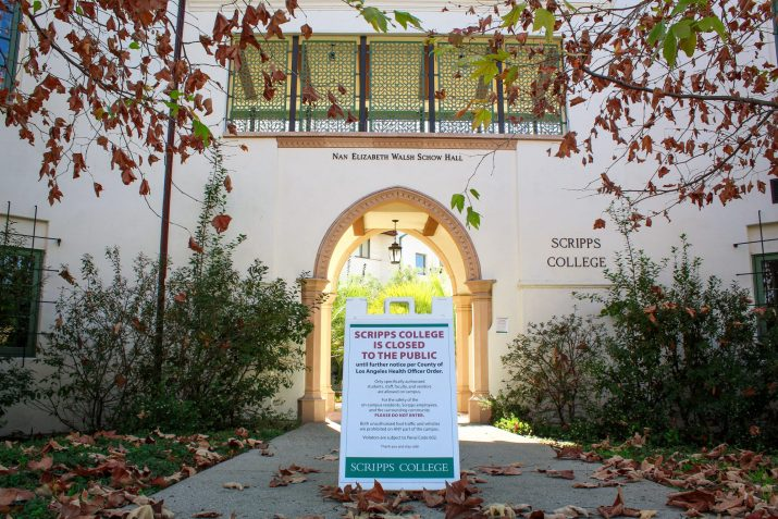 """A sign reading """"Scripps College is closed to the public"""" sits in front of Scripps' NEW Hall"""