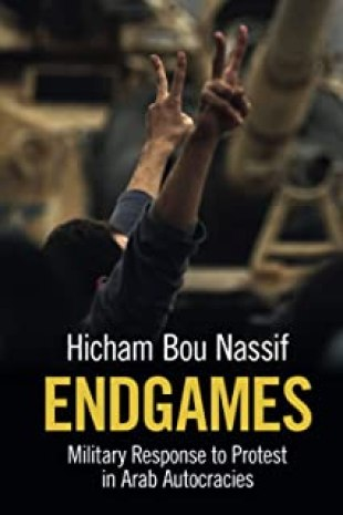 """A book cover of a man holding up two peace signs. The book is called """"Endgames: Military Response to Protest in Arab Autocracies"""" by Hicham Bou Nassif."""