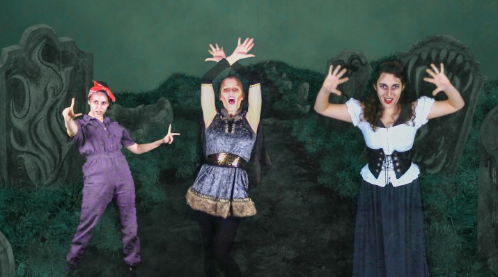 A screenshot from the virtual Addams Family production featuring three college actresses.
