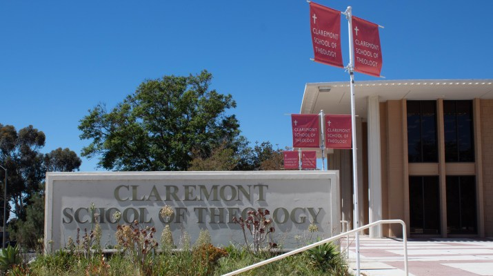 """""""A tall tan building stands proudly next to a Claremont School of Theology sign."""