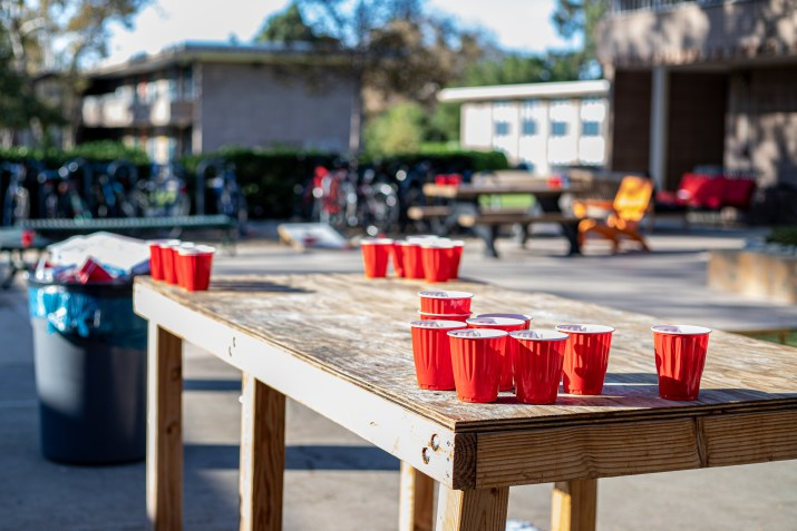 Empty cups sit on a table outside North Dorm at Harvey Mudd College.