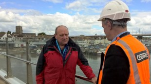 County Council Cabinet Member for Highways and Transport, John O'Brien, at the Adur Ferry Bridge in Shoreham-By-Sea