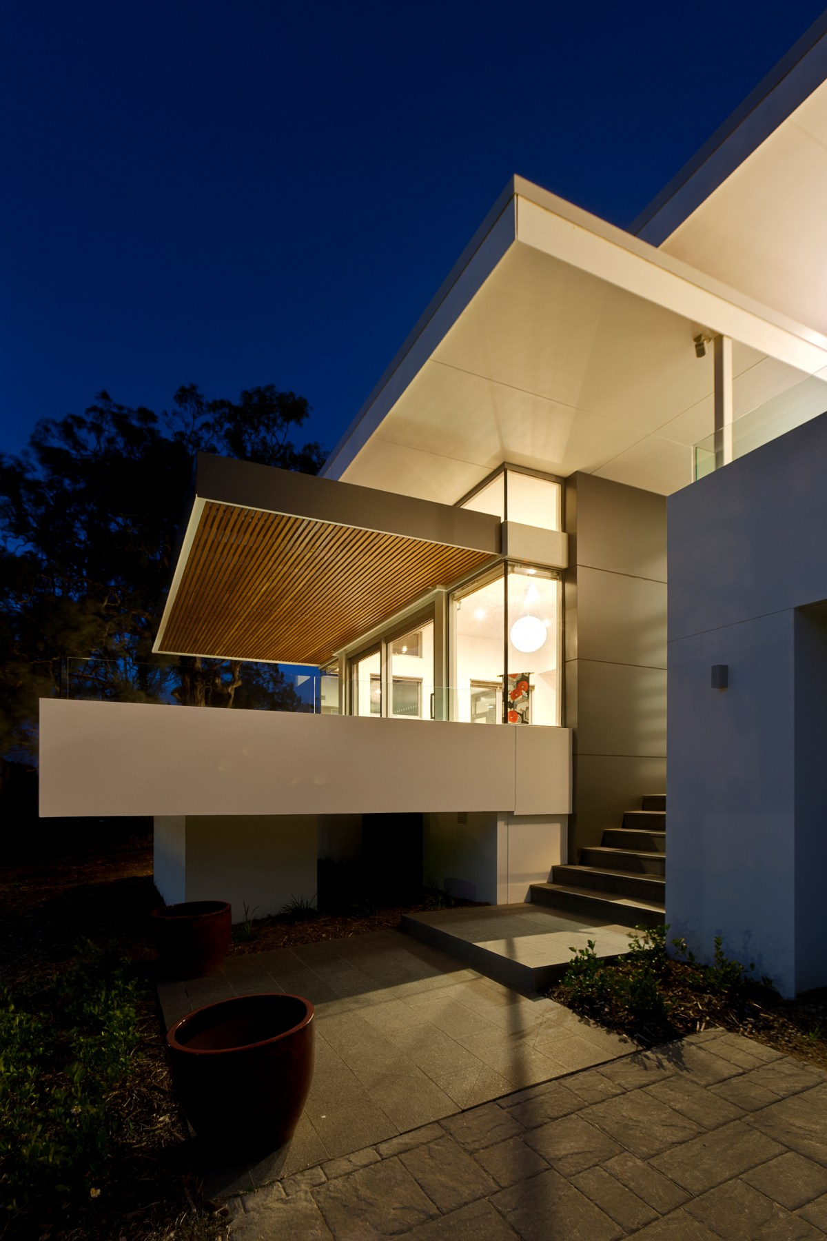 McGlade House - cantilevered deck with midcentury modern aesthetic