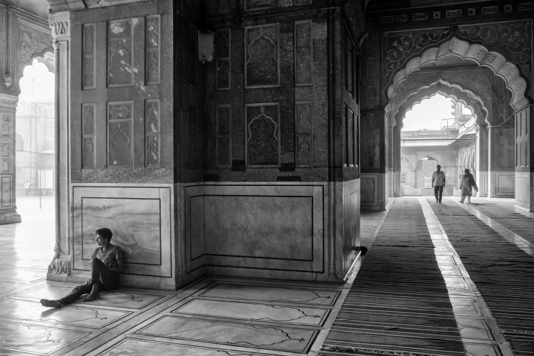 Man Sitting on Floor of Jama Masjid - Old Delhi, India - Copyright 2016 Ralph Velasco