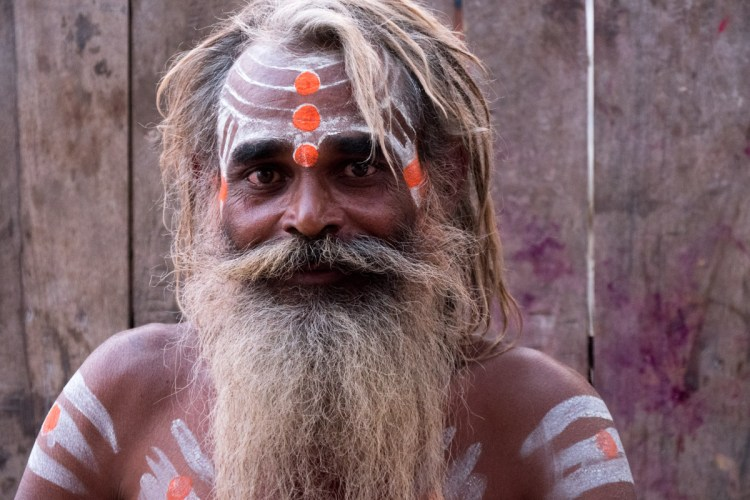 Sadhu Smiling Against Wood Wall - L - Varanasi, India - Copyright 2016 Ralph Velasco