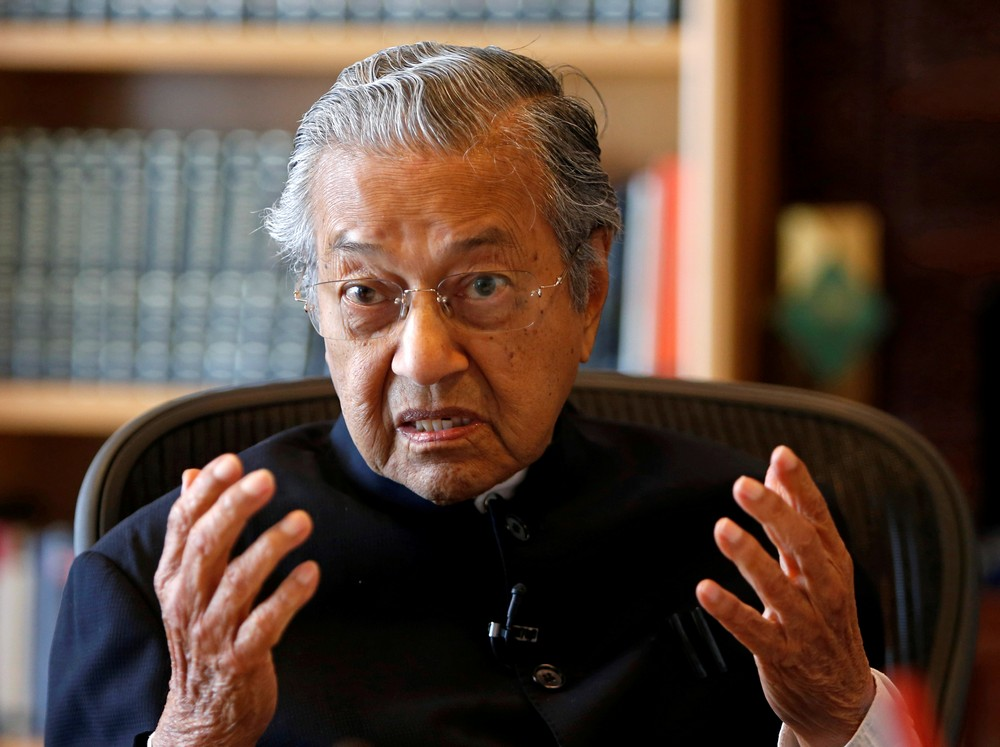 FILE PHOTO: Former Malaysian prime minister Mahathir speaks during an interview with Reuters in Putrajaya