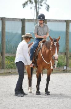 Peggy cummings works with a Connected Riding student.