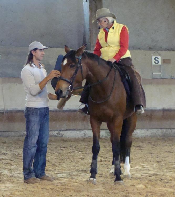 Frederic Pignon and Linda Tellington Jones work with a horse