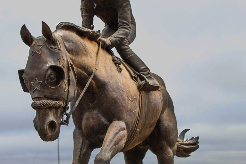 Dash for Cash Statue that stands outside the Four Sixes Ranch