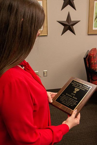 Kristina Butts with Award