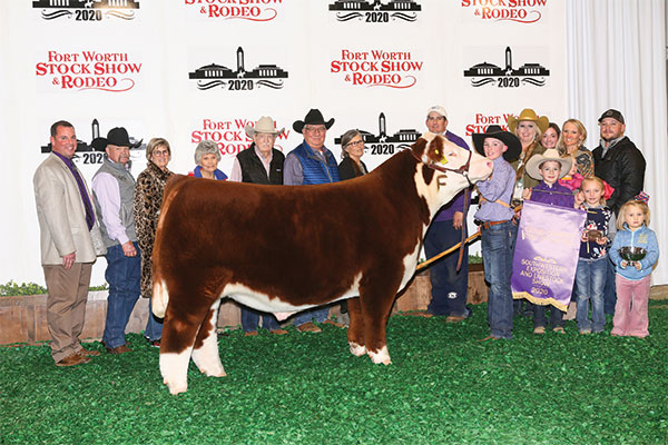 Photo of Day family with grand champion steer at Fort Worth.