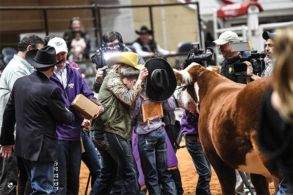 Photo of Ryder and Katie embracing each other after being picked grand champion.