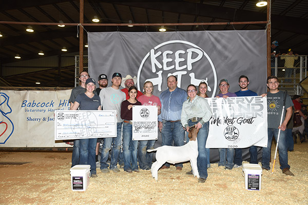 "Faith Snapp with her reserve grand champion market goat at the ""Keep it Weird"" goat show."