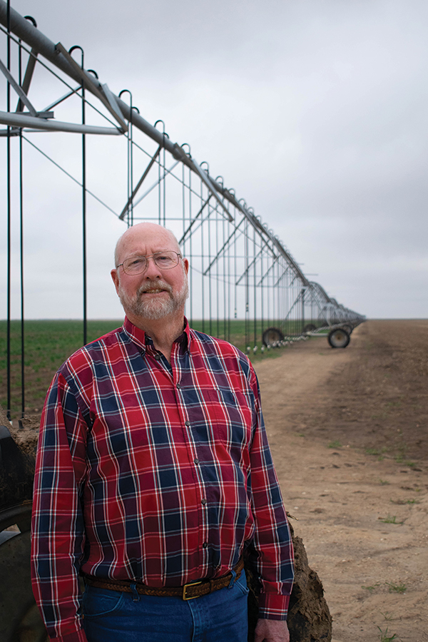 Wesley Spurlock stands by one of their Reinke center pivot systems.