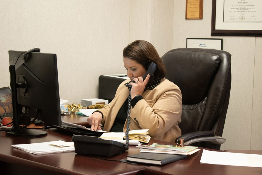 Norma Ritz Johnson on a phone call with sorghum growers.