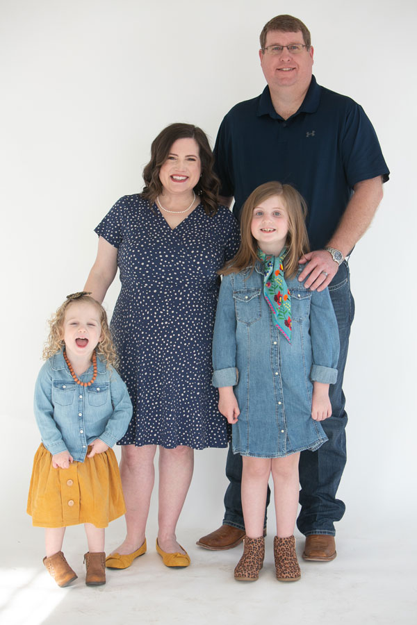 Katrina, her husband and their two daughters during their annual photo.